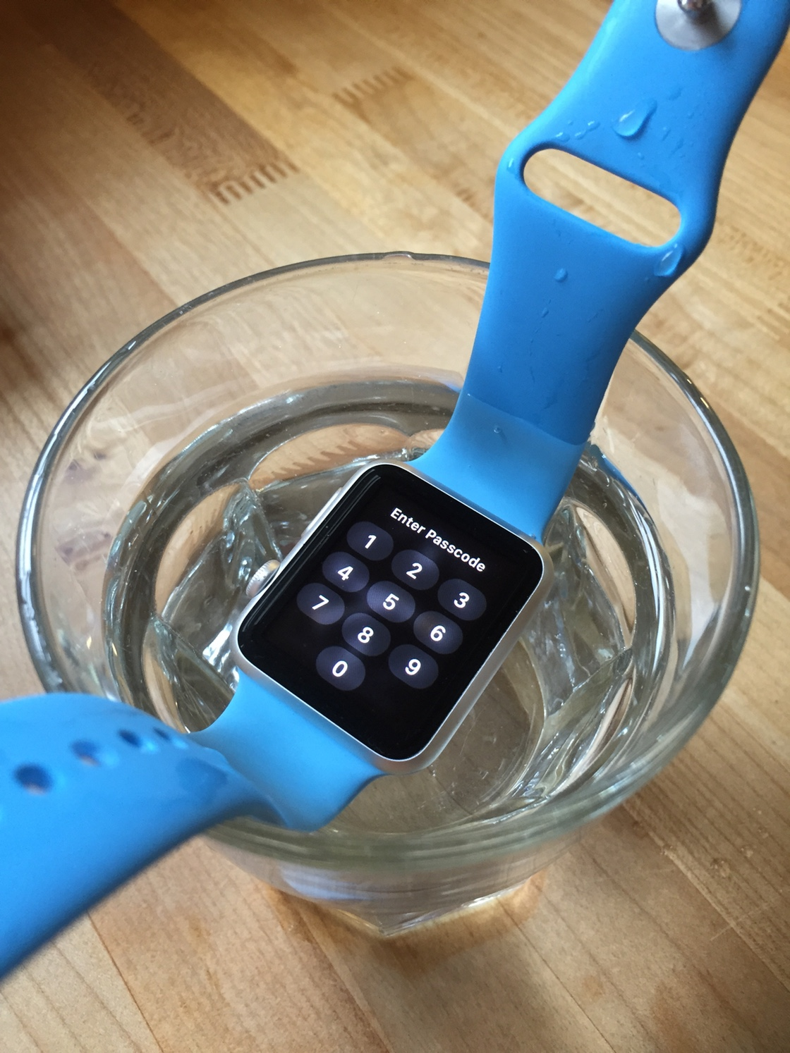 Passcode screen on submerged Apple Watch